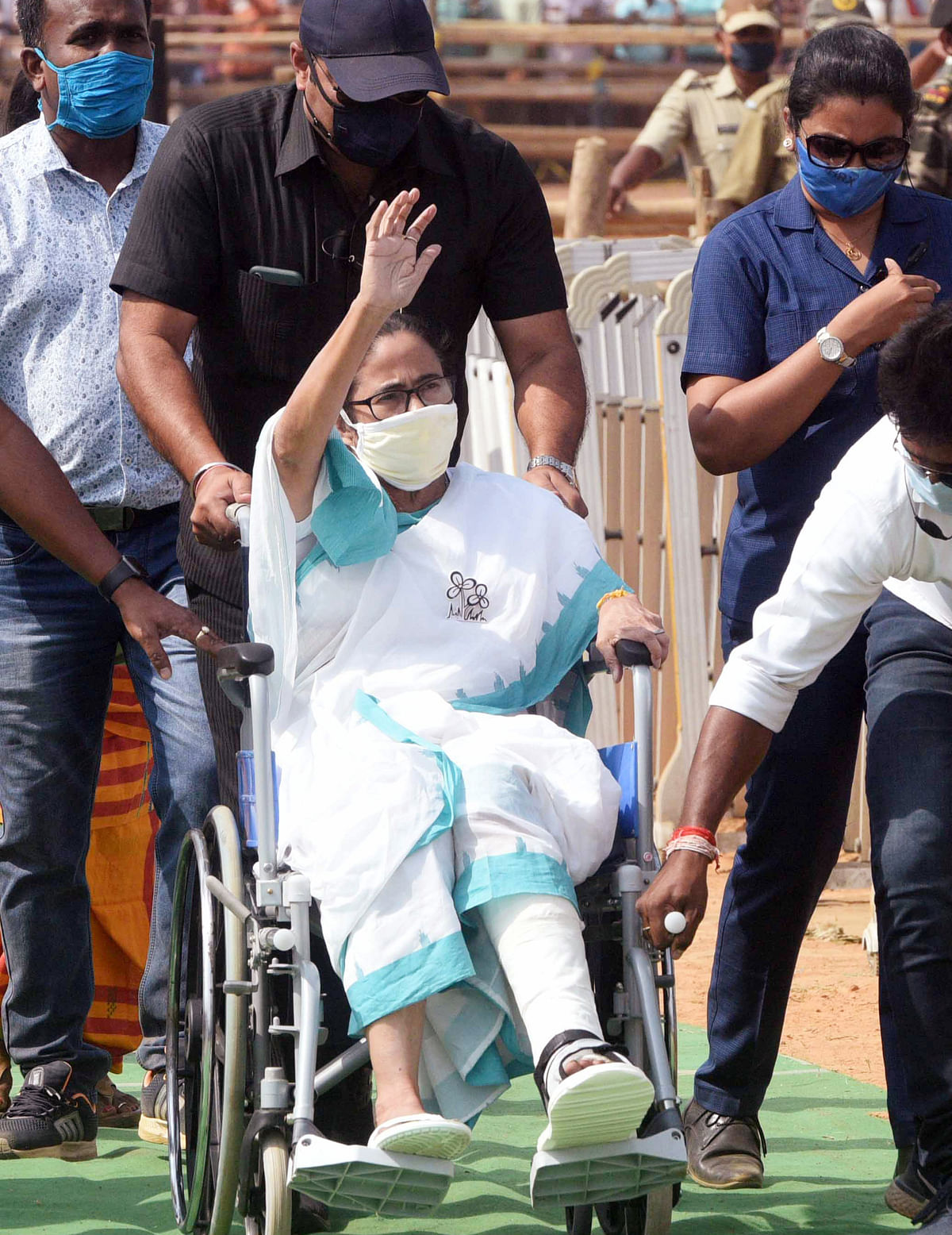 West Bengal CM Mamata Banerjee waving to her supporters during the campaign.