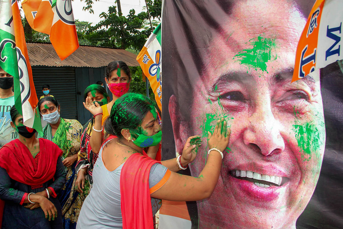 Trinamool Congress activists celebrate their party's victory in South Dinajpur district, Sunday, May 2,