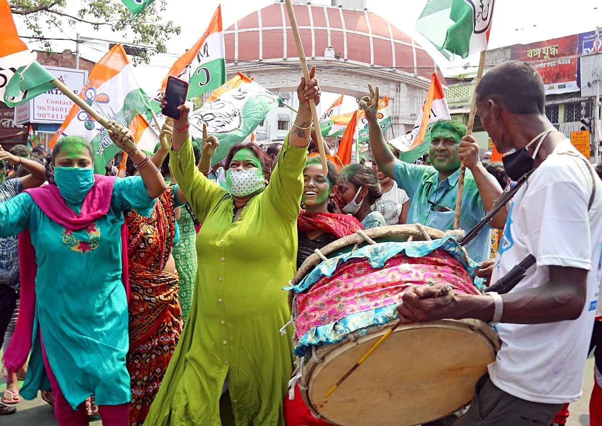 TMC women supporters celebrate the party's victory near West Bengal CM Mamata Banerjee's residence in Kolkata on Sunday, May 2