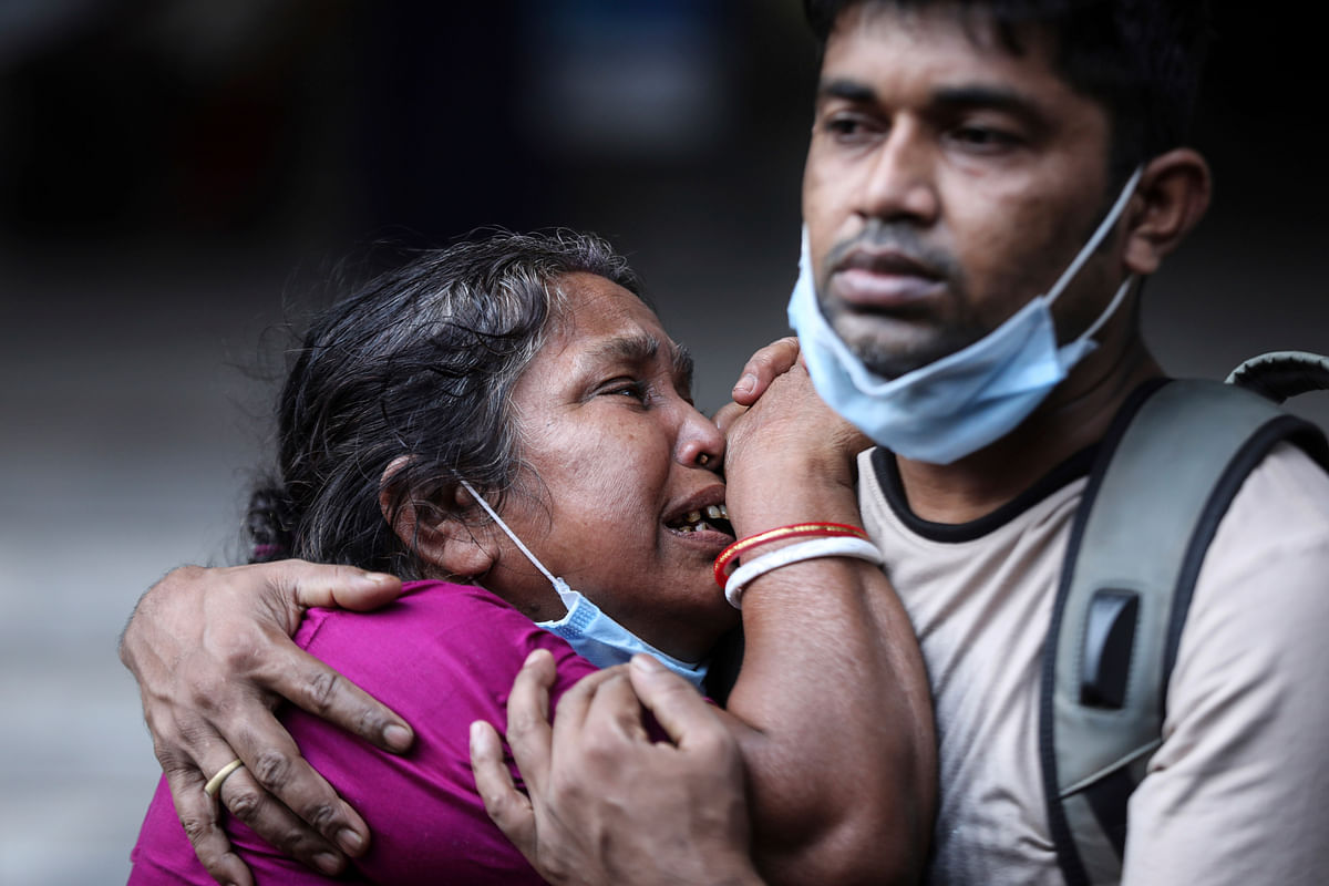 A Bangladeshi woman mourns the death of her husband who died of COVID-19 at a hospital in Dhaka, Bangladesh, Friday, May 7, 2021.