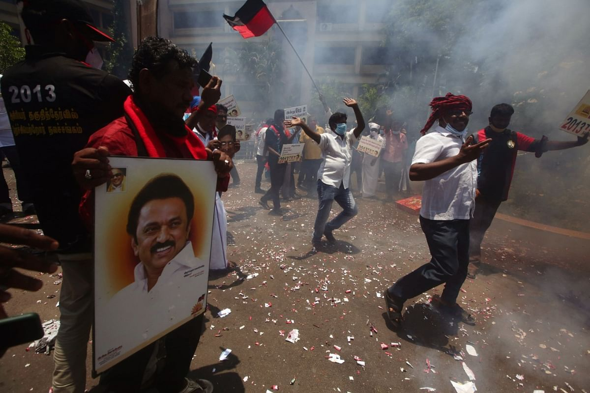 DMK party workers burn firecrackers as they celebrate their party's victory in Tamil Nadu state legislative assembly elections, at party headquarters in Chennai on Sunday
