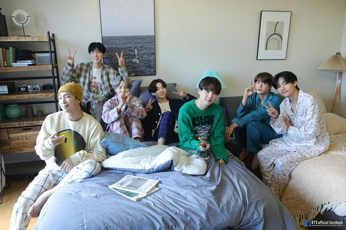 BTS posted this picture from their music video set featuring - RM, J-Hope, Jimin, Jungkook, Suga, Jin and V (L-R)