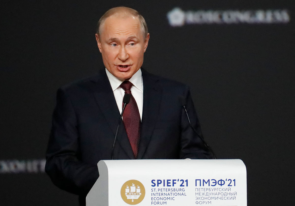Russian President Vladimir Putin gives a speech during a plenary session of the St. Petersburg International Economic Forum (SPIEF) in Saint Petersburg on June 4, 2021