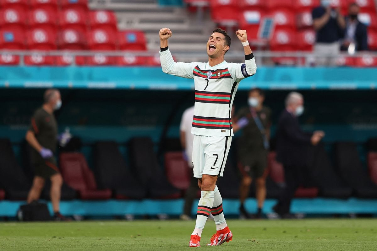 Portugal's forward Cristiano Ronaldo celebrates at the end of the UEFA EURO 2020 Group F football match between Hungary and Portugal at the Puskas Arena in Budapest on June 15, 2021.