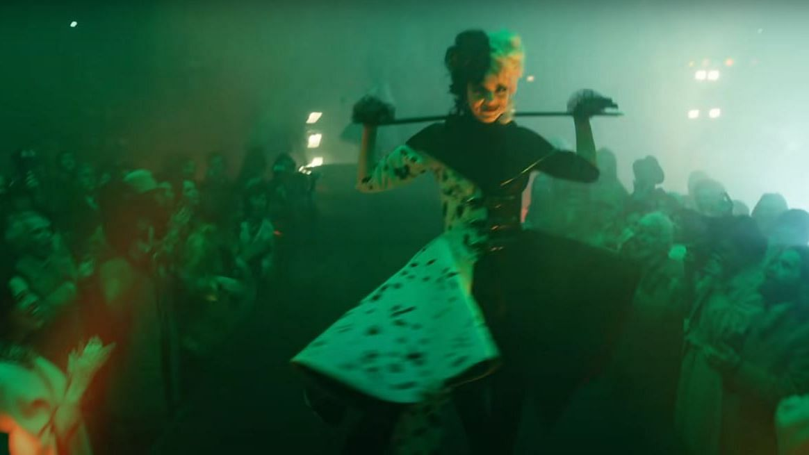A screenshot from the film trailer of 'Cruella' featuring actor Emma Stone in the iconic black and white ensemble