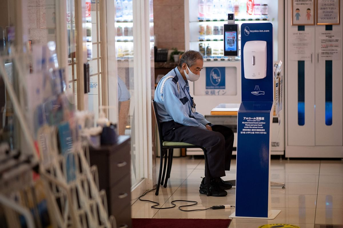 A security officer checks quarantine measures, in place due to the Covid-19 coronavirus, in a hotel in Tokyo on July 20, 2021