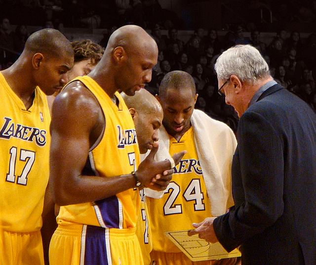 Kobe Bryant (centre) led Lakers won two consecutive championships under Coach Phil Jackson(right)