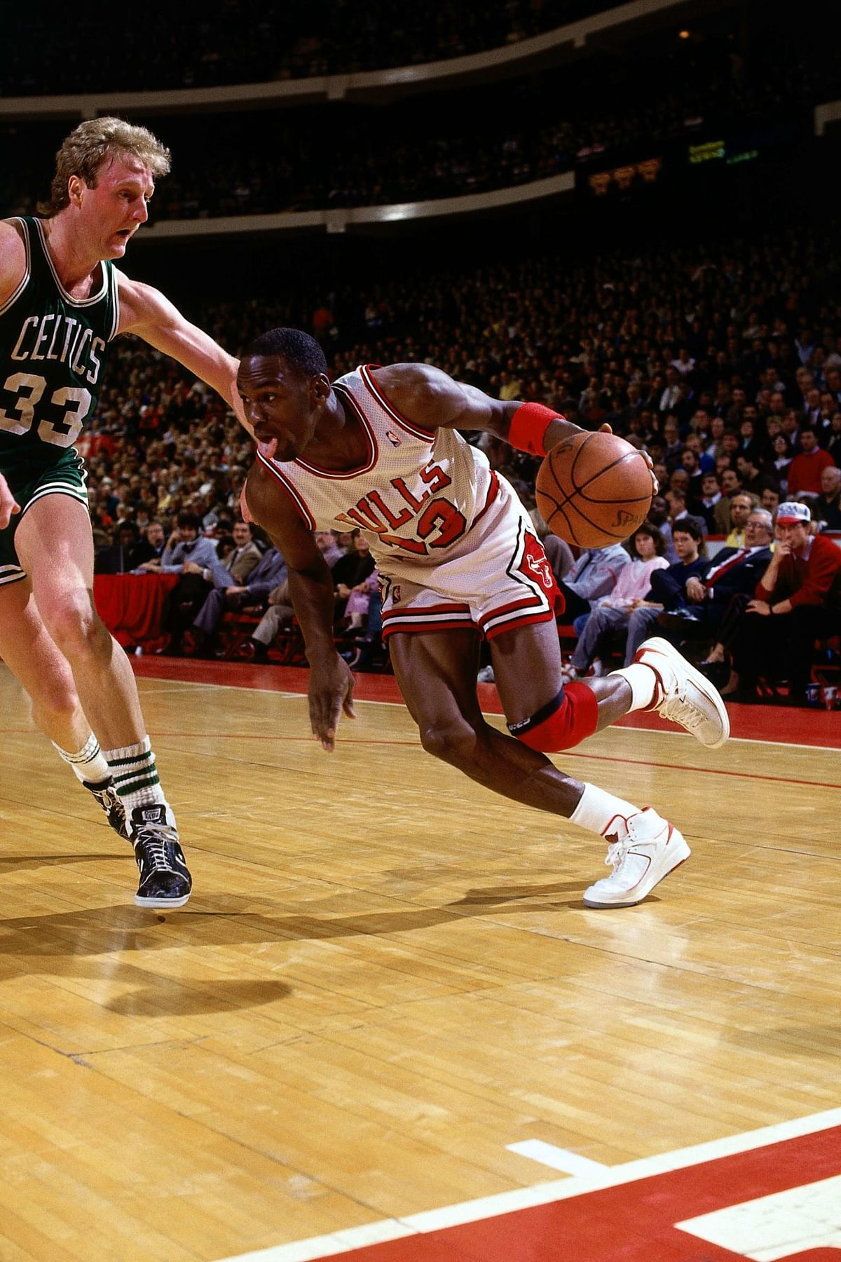 Micheal Jordan (right) takes on the great Larry Bird (Left)
