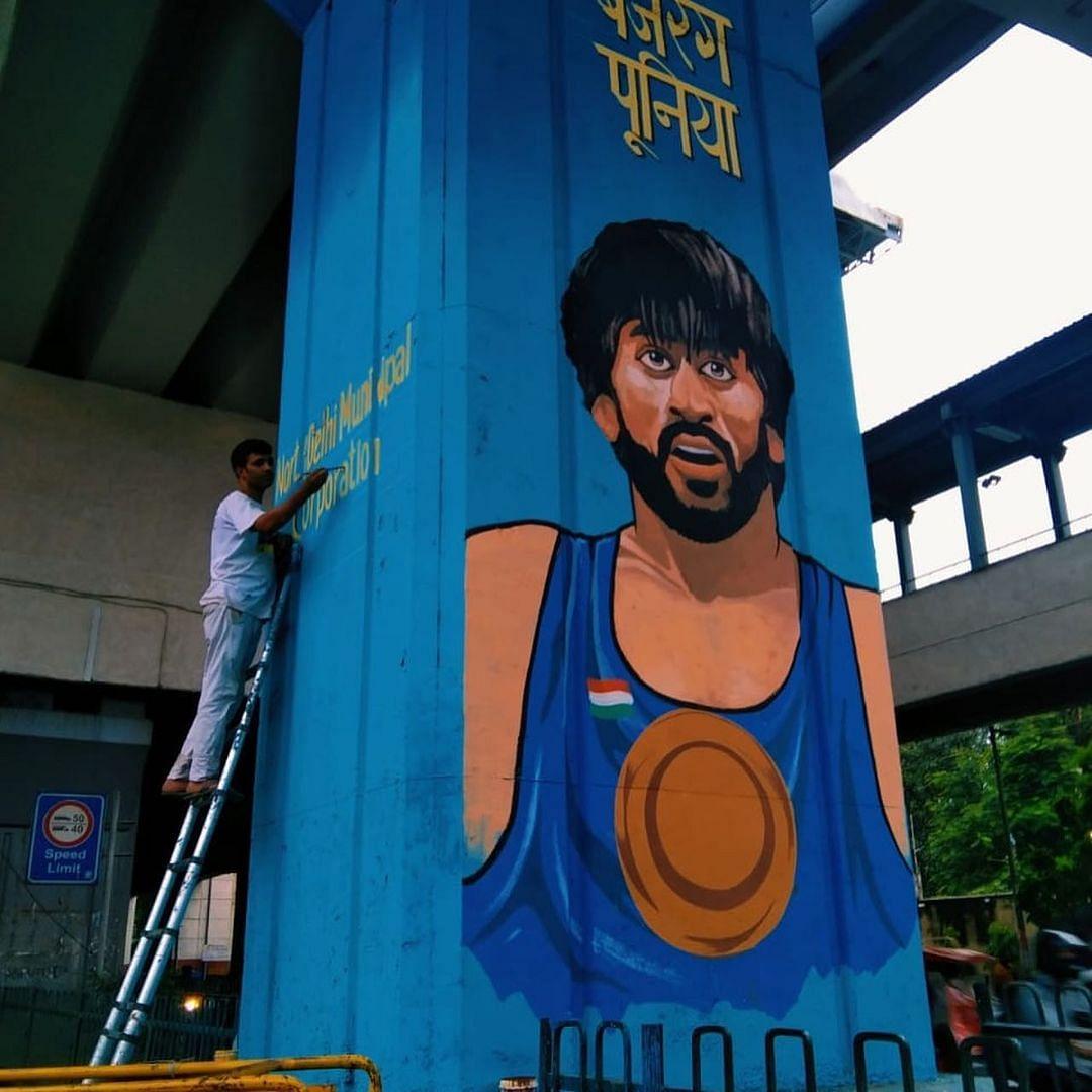 The DSA crew immortalizing Bajrang Punia in the streets of Delhi