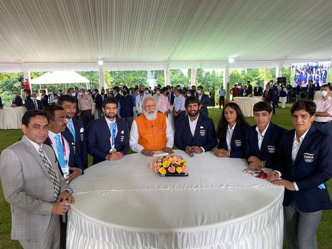 PM Modi interacts with the Indian wrestling team at the Red Fort after the Olympics