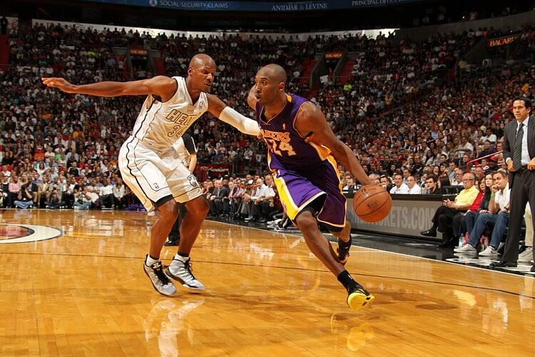 Kobe Bryant (right) looks to drive past Ray Allen (left)