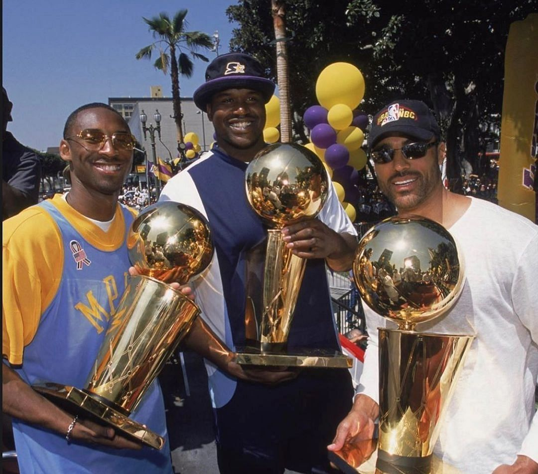 Kobe Bryant (left), Shaquille O'Neal(centre) and Rick Fox (right) celebrate their third consecutive championship.