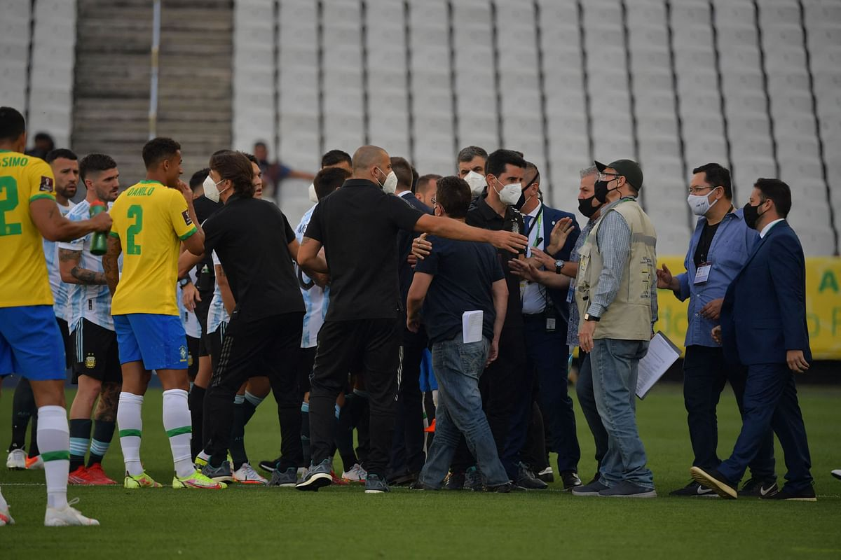 Brazil's health ministry officials stormed onto the pitch to order the game to be halted.