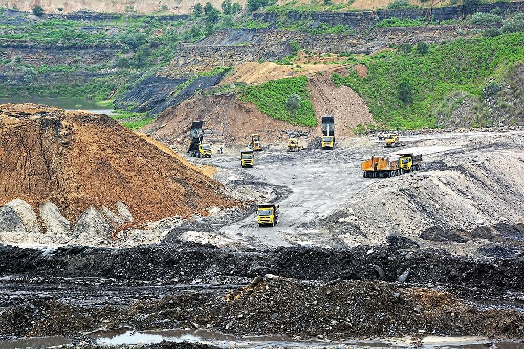Mining trucks at work, at a coal mining site
