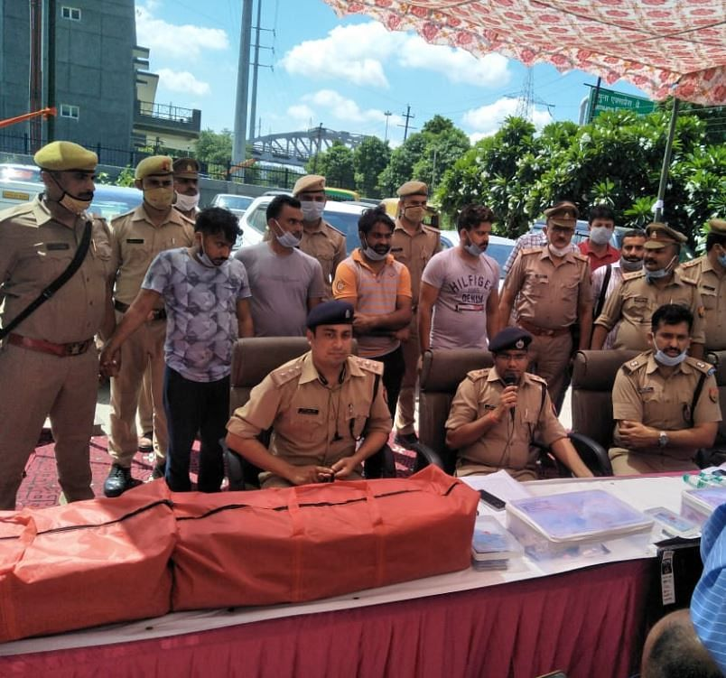 Noida Police Arrests Four With 3 Kg Gold, 27 Mobile Phones, 63 Laptops, 96 Cheque Books And What Not!