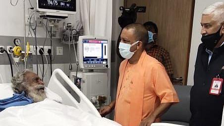 Yogi Visits Mahant Nritya Gopal Das At Medanta Hospital