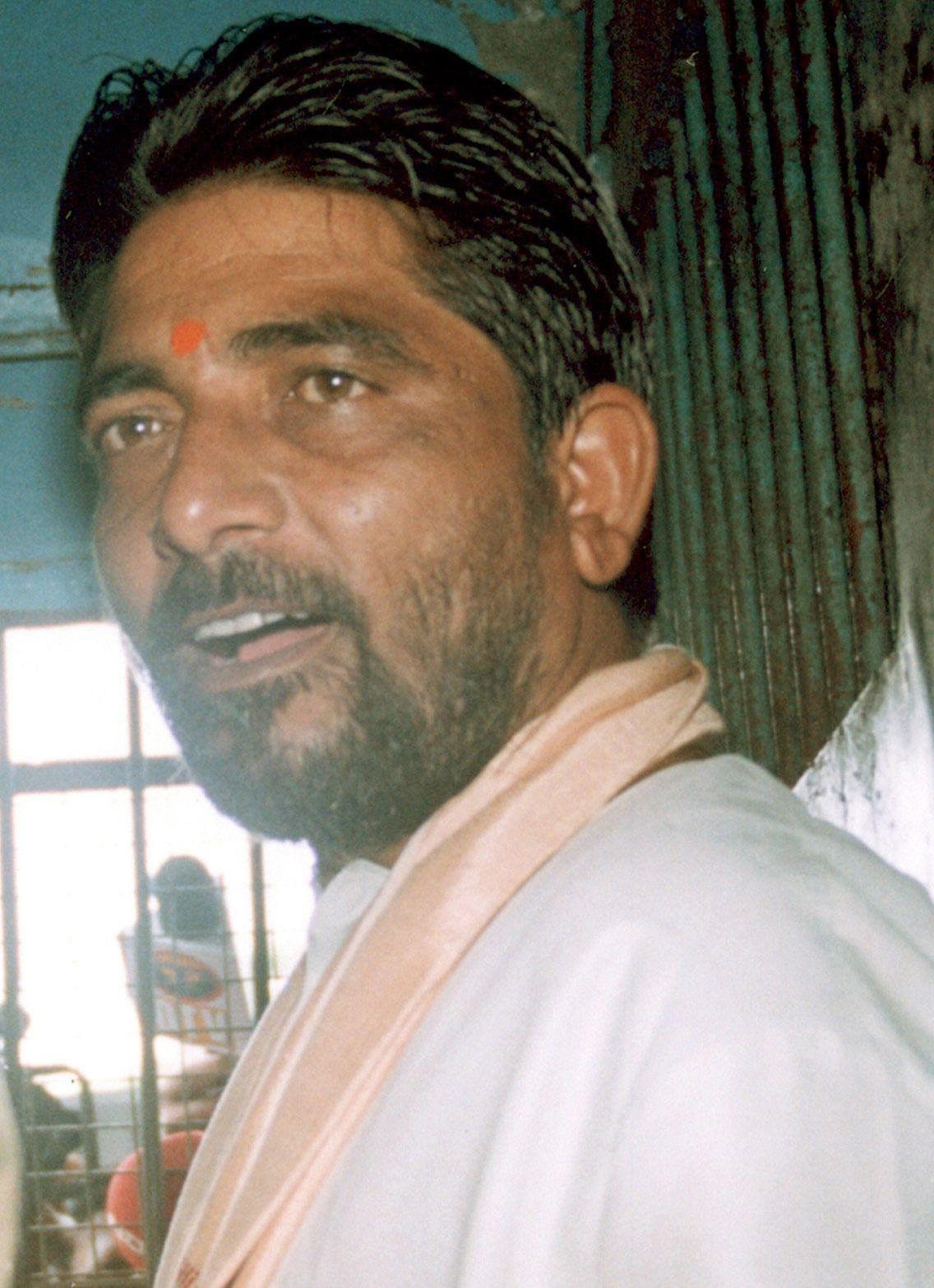 Hindu activist and ringleader Dara Singh is seated in a police van in Bhubaneswar.