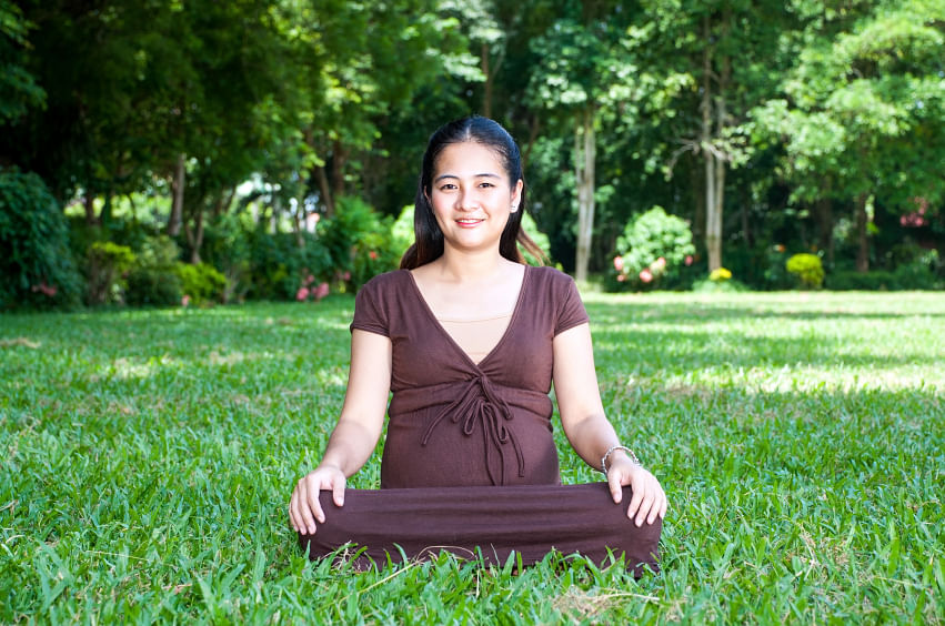 Avoid fitted yoga clothes that may cause discomfort. (Photo: iStock)