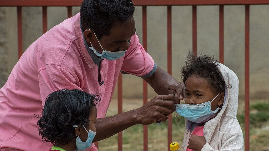 Face masks are placed on children in Antananarivo, Madagascar on 3 October 2017.