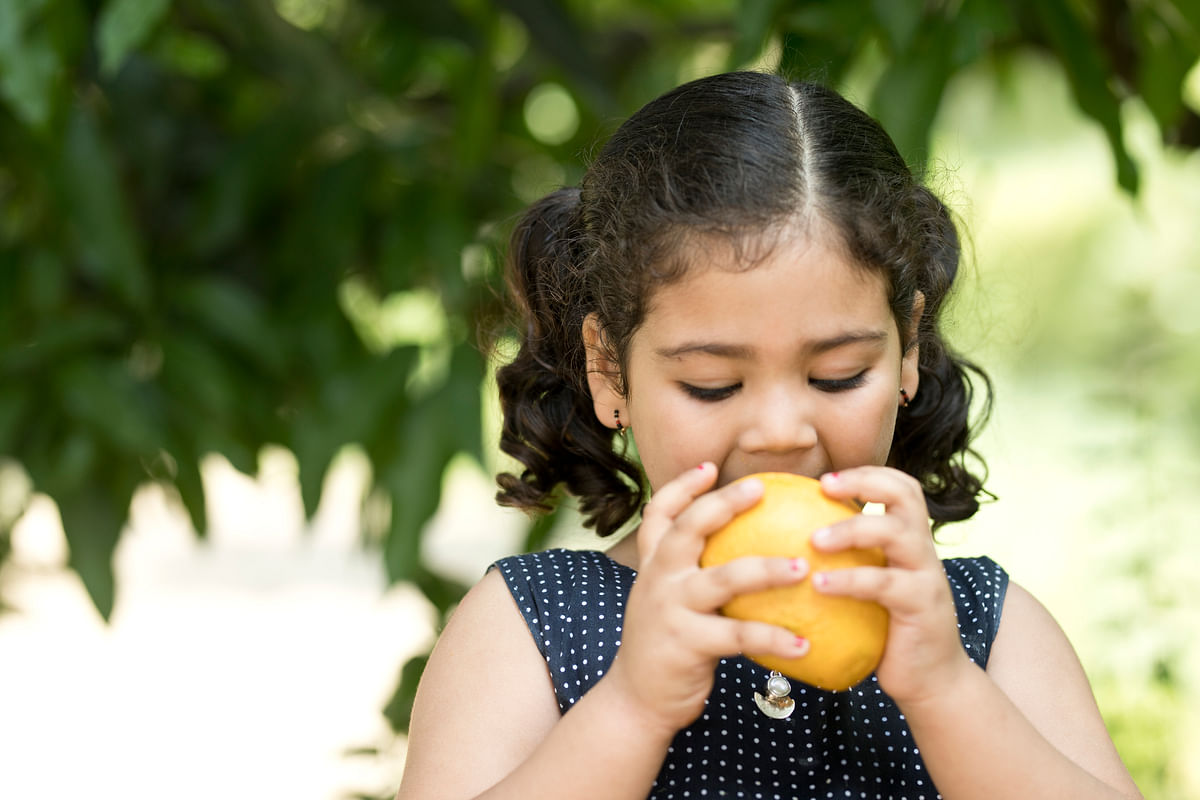 As long as you are not in the infected area or the surrounding areas, it's safe to consume fruits.
