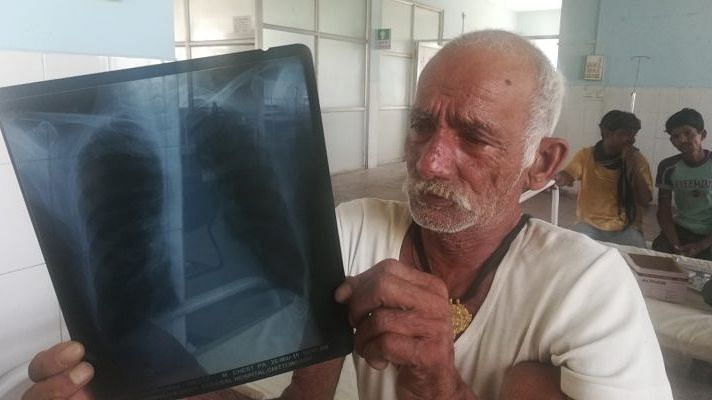 "Mangal Lal, 70, a farmer from Achalpura village, Chittorgarh, Rajasthan suffers from COPD. Lal was a beedi smoker all his life but quit three years ago. ""I cook my own food on the <em>chulha</em>,"" he says."