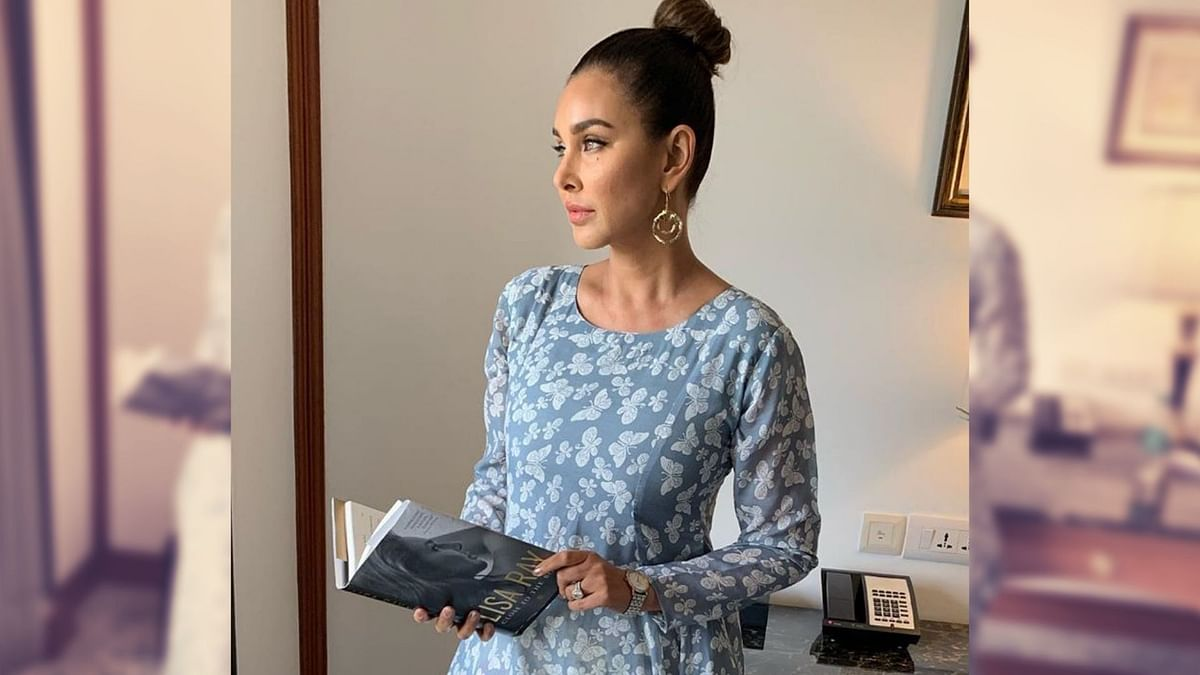 Lisa Ray poses with a copy of her book, Close to the Bone