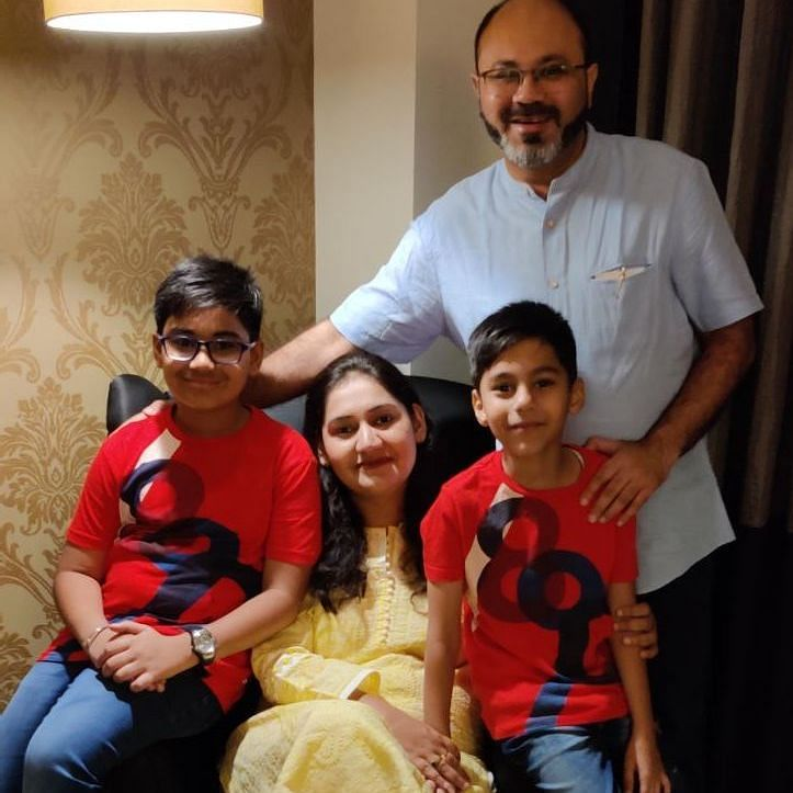 Harsh with his wife and two sons.