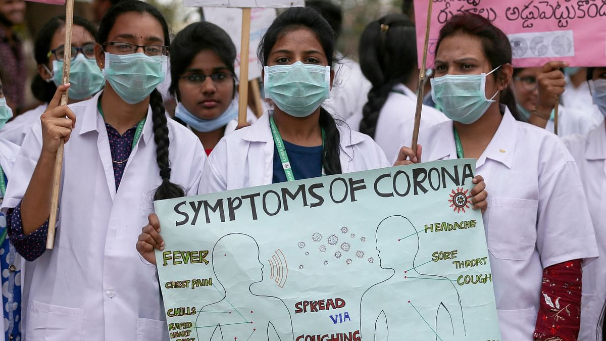 Indian medical students hold a placard during an awareness rally for COVID-19 in Hyderabad on 6 March 2020. Image used for representational purposes.