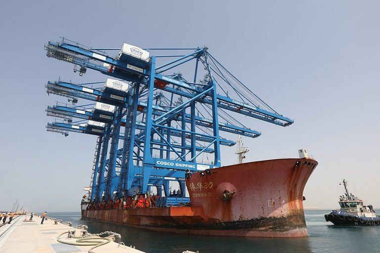 The cranes being delivered into port