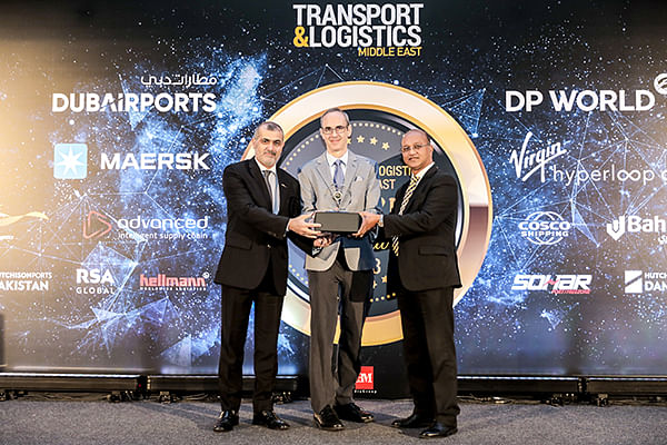 <em>Ramzi Al Zerouni (left), General Manager – Administration, Government &amp; Business Affairs, and Paul Rehmet, Chief Product Officer (center), accept the Logistics Technology Platform of the Year award from Jude Fernandes, Head of Cargo Business Planning, Dubai Airports (right).</em>