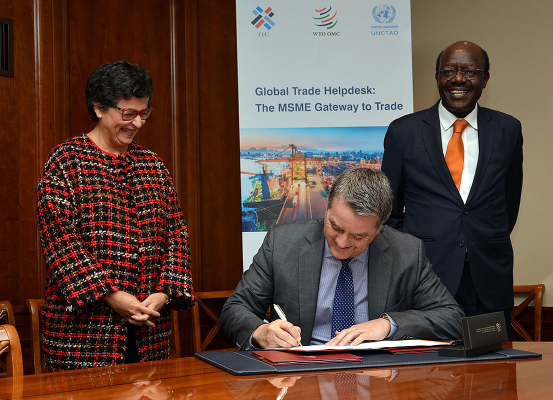 The signing of the MoU between Mukhisa Kituyi, Secretary-General of UNCTAD; Arancha González, Executive Director of the ITC; and WTO Director-General Roberto Azevêdo