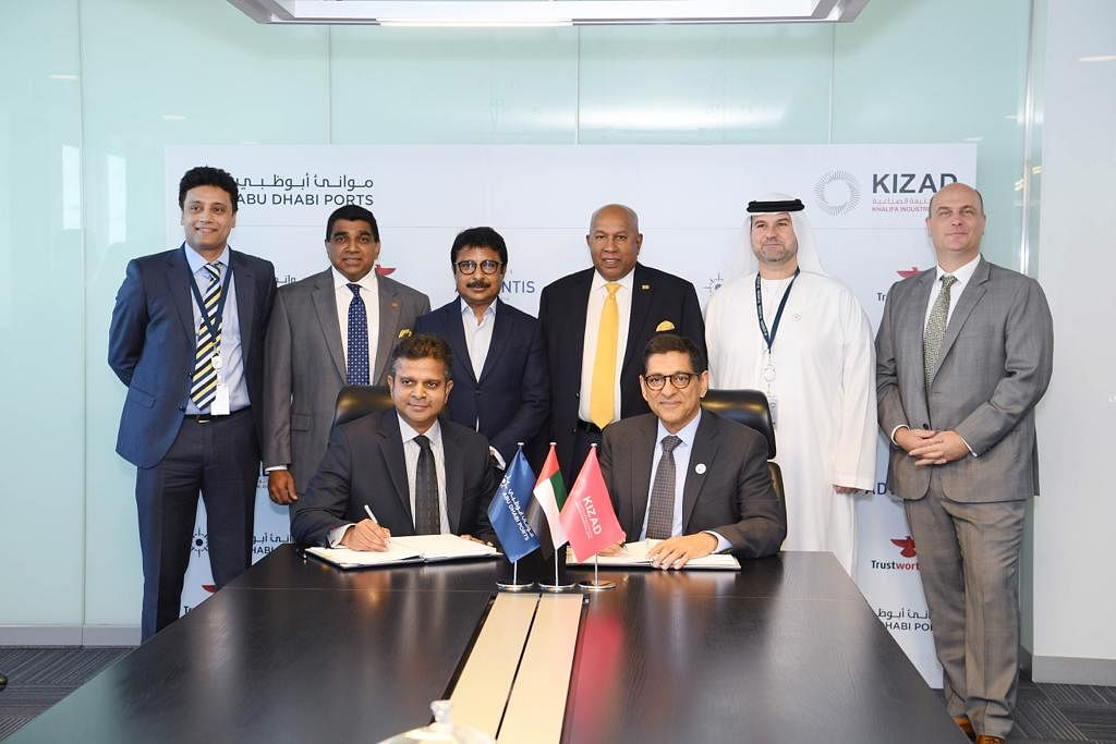Mr. Jalal Essudeen, Executive Director, Trustworthy.ae Group and Mr.Samir Chaturvedi, CEO, KIZAD, sign the investment agreement on Sunday. Mr. Abdul Lathif, Managing Director, Trustworthy.ae Group (third from left), Mr. Mohan Pandithage, Chairman, Hayleys PLC (third from right) and senior directors from Hayleys Advantis Limited, KIZAD and Abu Dhabi Ports were also present on the occasion.