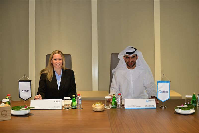 The signing of the agreement between Arup and Smart Dubai (R)