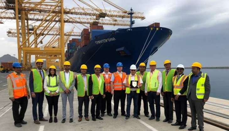 To mark the occasion, Fred Castonguay and other senior management of Gulftainer, present a commemorative shield to the vessel master, Captain Razvan Adrian Nita.