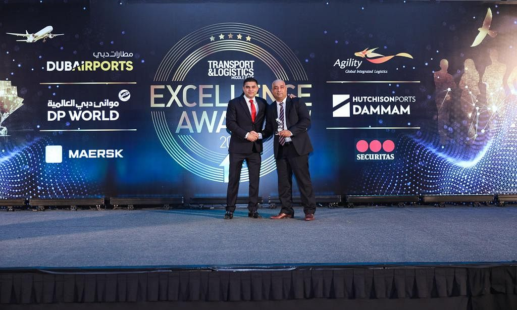 TLME CEO Sam Khan delivers the award