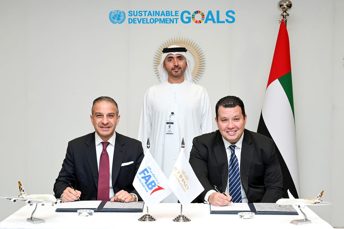 From left to right, Andy Cairns, Head of Global Corporate Finance at First Abu Dhabi Bank; Khaled Khalfan AlSuwaidi, Chief Operating Officer at Abu Dhabi Global Market; Adam Boukadida, Senior Vice President Treasury, Tax & Finance at Etihad Aviation Group during the signing ceremony of the Memorandum of Understanding at Abu Dhabi Global Market.