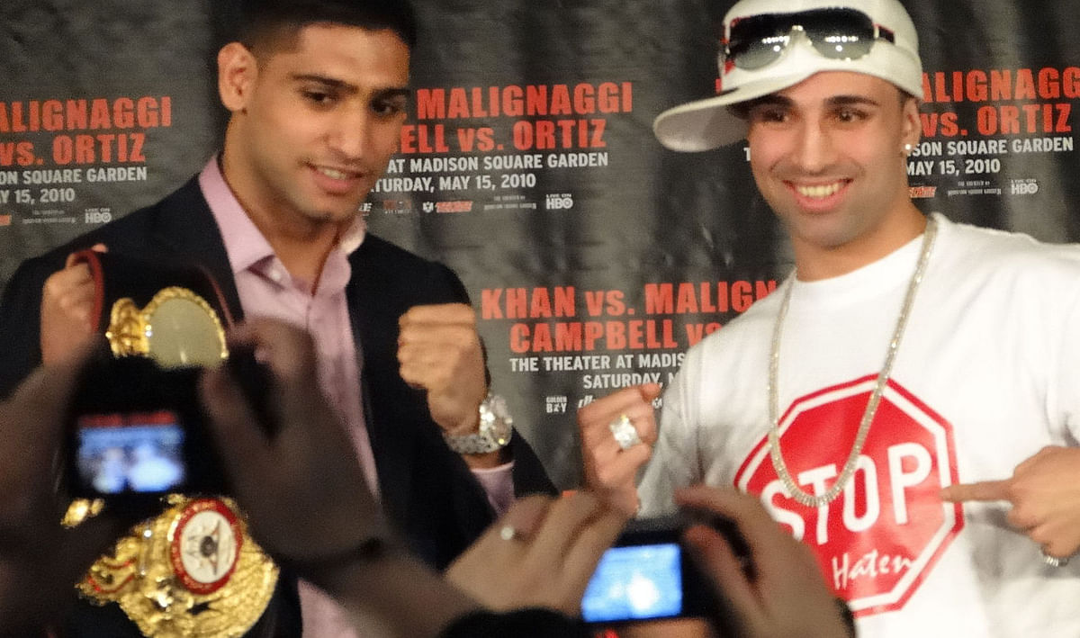 Amir Khan before his victory over Paulie Malignaggi (pictured right)