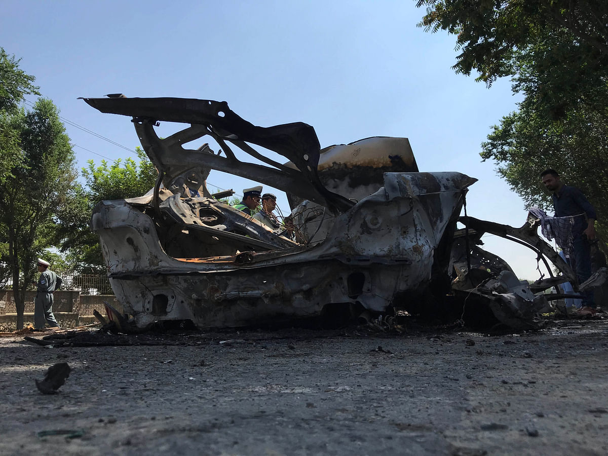 Damaged vehicle in a blast at the southern gate of Kabul University in Kabul