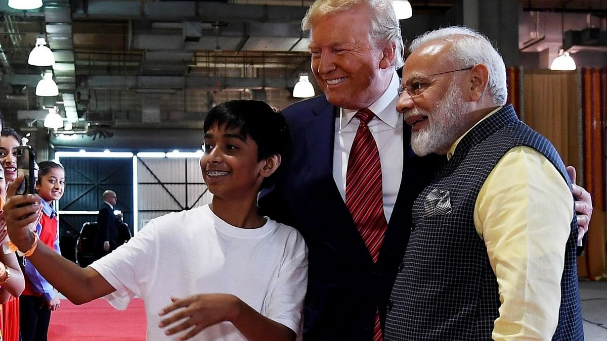 Prime Minister Narendra Modi and US President Donald Trump pose for a selfie with a kid in Huston