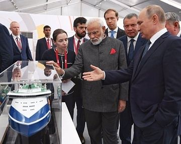 PM visits ship-building facility along with Putin