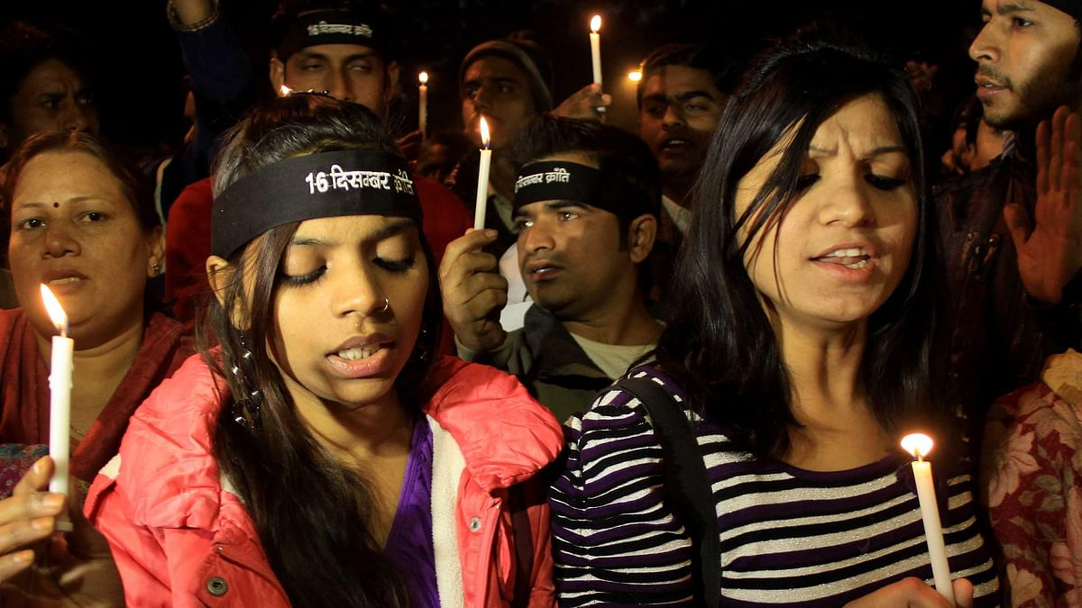People participate in a candle light march to pay homage to `Nirbhaya`