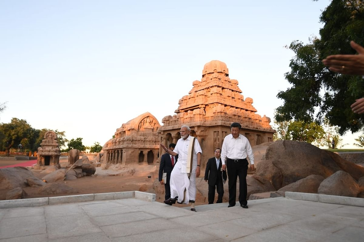 Prime Minister Narendra Modi and Chinese President Xi Jinping during their visit to Pancha Rathas complex in Mahabalipuram