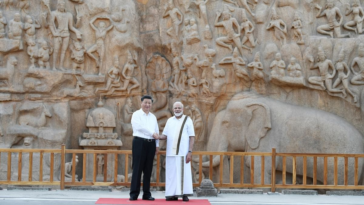 Prime Minister Narendra Modi and Chinese President Xi Jinping during their visit to Pancha Rathas complex in Mahabalipuram, Tamil Nadu