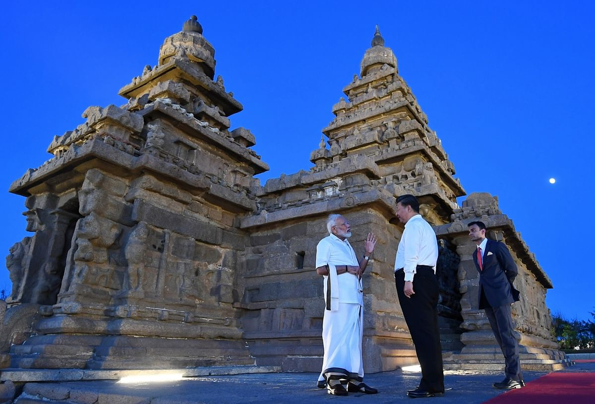 Prime Minister Narendra Modi and Chinese President Xi Jinping during their visit to Shore Temple in Mahabalipuram
