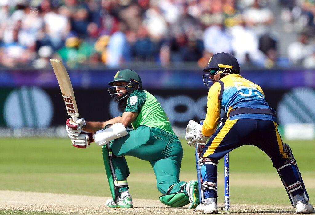 South Africa's batsman Hashim Amla, left, watches his shot.