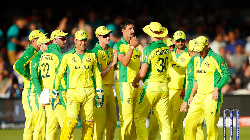 Australia's Mitchell Starc, centre, celebrates with his teammates after taking the wicket of New Zealand's captain Kane Williamson.