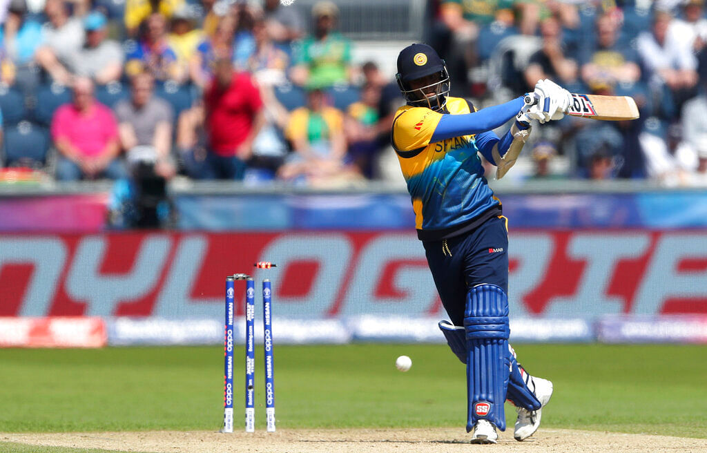Angelo Mathews is bowled by South Africa's bowler Chris Morris.