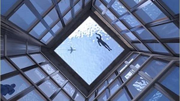 நெட்டிசன்களை குழப்பத்தில் ஆழ்த்திய புகைப்படம்! - லண்டனில் அமைய உள்ள உலகின் முதல் 360 டிகிரி நீச்சல்குளம்