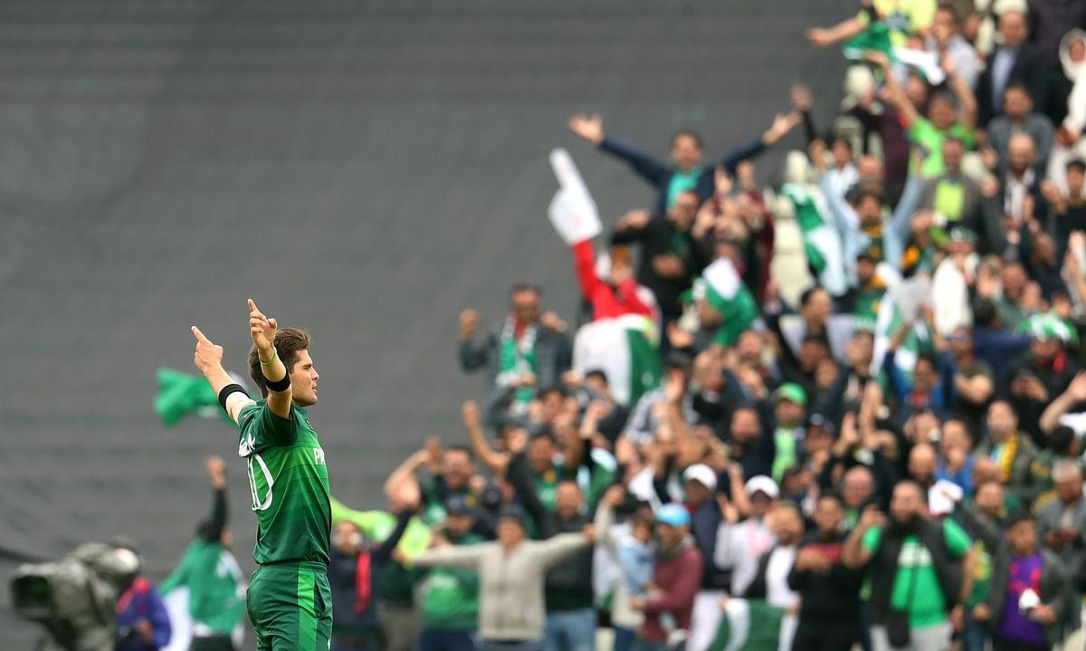 Shaheen Afridi celebrates after dismissing New Zealand's batsman Colin Munro.
