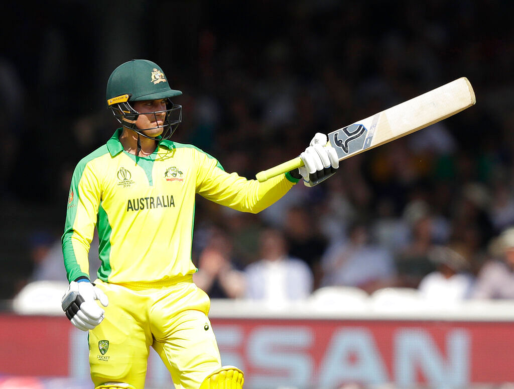 Australia's Alex Carey celebrates getting 50 runs not out during the Cricket World Cup match between New Zealand and Australia.